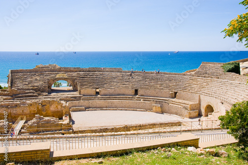 view of roman amphitheater against sea in Tarragona, in Spain