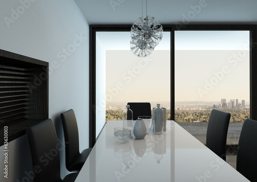 White dining table against floor to ceiling window
