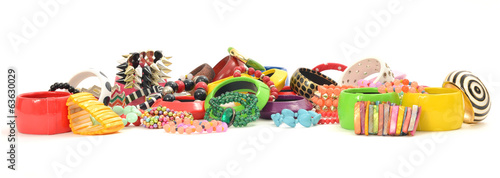 Close up on many, diversed colorful bracelets,beeing fashionable
