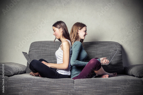 typing friends on the sofa
