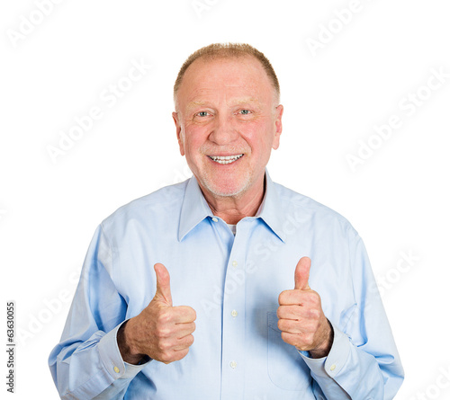Old happy, smiling man giving thumbs up