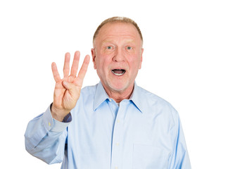 Senior elderly man showing the number four hand gesture