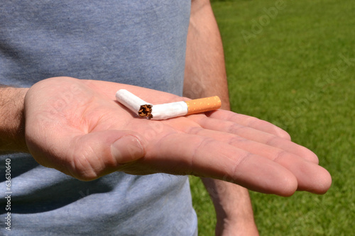Broken cigarette in a hand