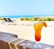 Leinwandbild Motiv Orange cocktail on the beach