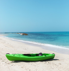 Green kayak on the beach