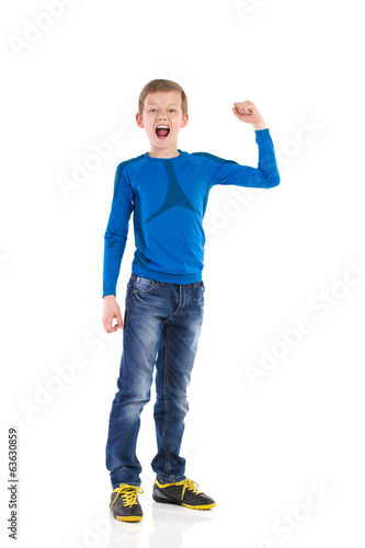 Shouting young boy with arm raised.