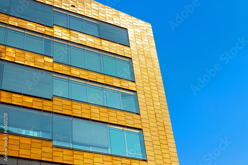 Modern office building with a golden facade