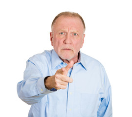 Portrait serious, upset older man pointing fingers at someone