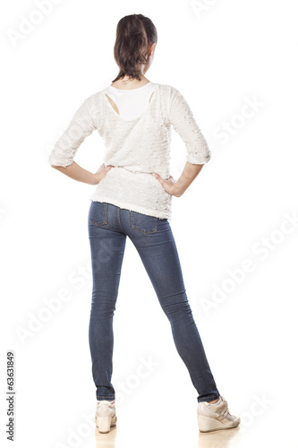 Rear view of a girl in jeans and blouse