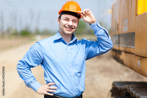 Smiling engineer in a construction site