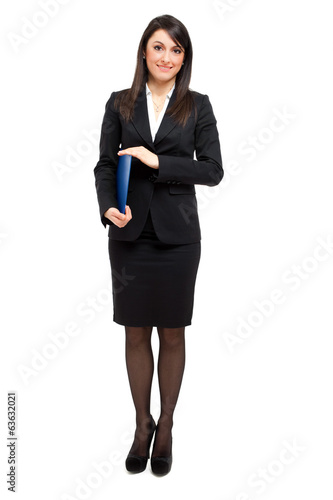 Businesswoman full length holding documents