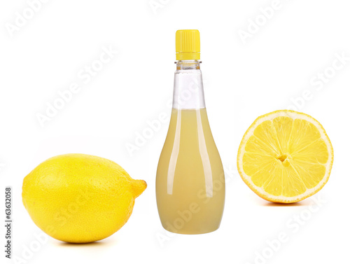 Jar of lemon sauce and lemons.