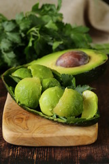 salad of fresh avocado on a wooden board