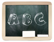 Blackboard with sketchy ABC written on it isolated