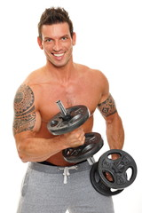 Handsome man exercises with dumbbells biceps and poses