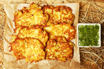 Potato hash brown served with dry hay and sour-cream