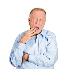 Headshot yawning older man isolated on white background