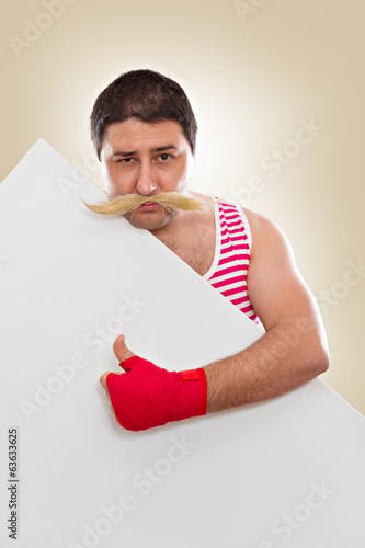 Funny boxer with mustaches pointing at white board