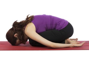 Woman in Childs Pose during Yoga