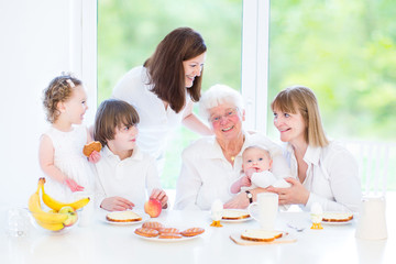 Grandmother enjoying breakfast with daughter, granddaughter