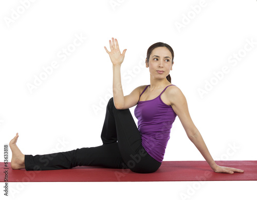 Woman doing Marichis Pose in Yoga