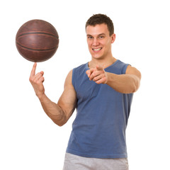 Basketball player spinning the bal. Isolated on white background