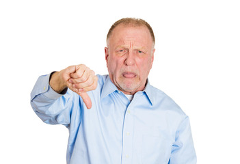 Old, unhappy, displeased man giving  thumbs down