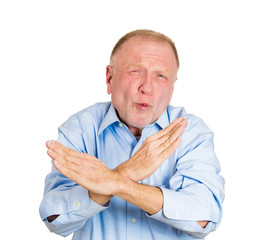 Portrait older man showing X sign, warning not to cross line