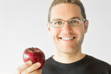 Portrait of a young man holding and apple