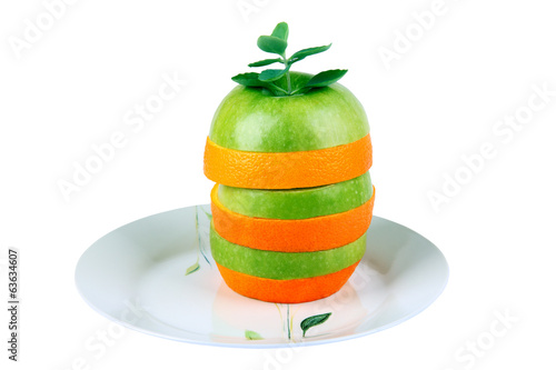 Apple and orange. Fruit mix on a plate.