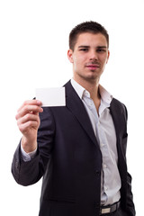 Young businessman showing empty business card