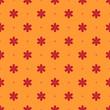 Seamless floral ornament on orange background