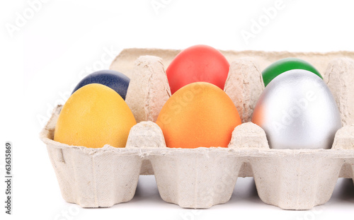 Fresh colourful eggs in case.