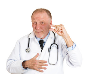 Portrait senior doctor showing just a little bit hand gesture