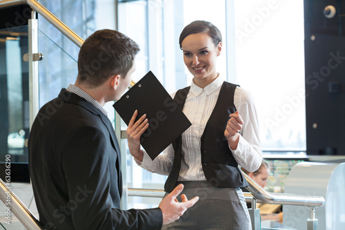 Two office workers talking