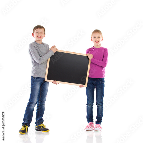Boy and girl holding blackboard.