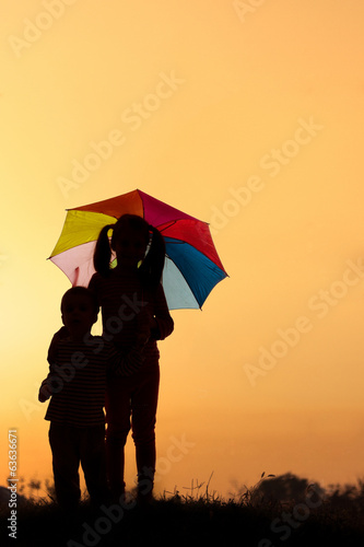Silhouette of little boy and girl