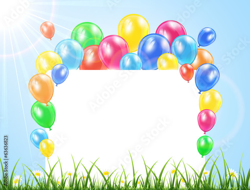 Balloons and banner on a grass
