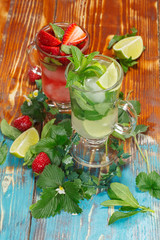 Refreshing mojito cocktails, lime and strawberry with mint