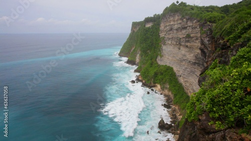 aves of the Indian Ocean break about coastal rock