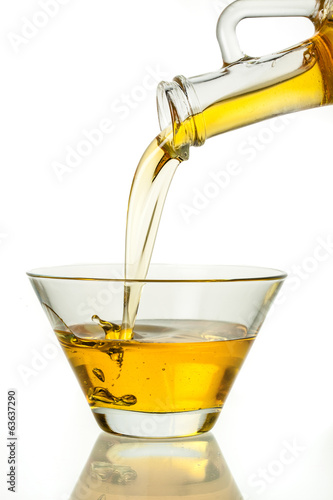 Oil jet is pouring with splash isolated on white background