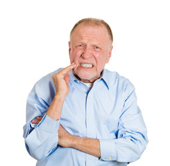 Senior man having bad tooth pain, sensitive teeth