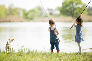 Two little girls fishing
