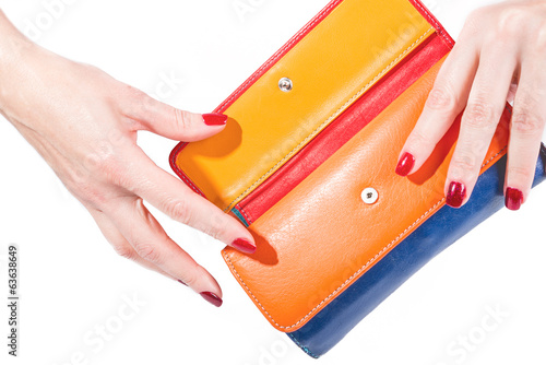 Hands holding multicolor wallet on white background
