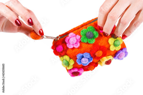 Woman hands holding retro wallet on white background
