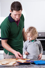 Father and son preparing breakfast