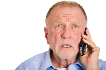 Depressed sad old man receiving bad news on phone