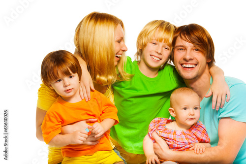 Laughing parents with three kids