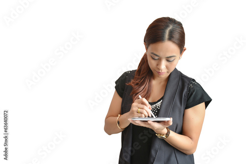 businesswoman smiling and working on tablet computer