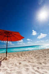 Sun and umbrella on the beach